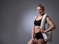 Muscular woman with towel