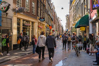 People at streets of Amsterdam during spring time