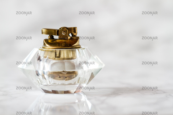 Vintage Glass Table Lighter on White Marble Background