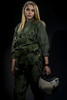 Beautiful Female Fighter Pilot Wearing A Flightsuit And Holding A Helmet In A Studio Environment