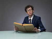 Funny man reading a book