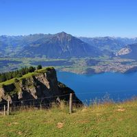 Stunning view from Mount Niederhorn. Azure blue Lake Thun and Mount Niesen Bernese Oberland, Switzerland.