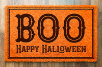 Boo, Happy Halloween Orange Welcome Mat On Wood Floor Background