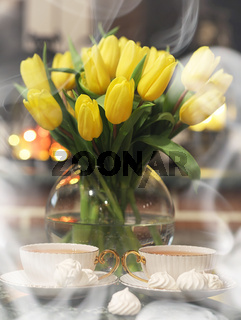 A bouquet of yellow tulips in a vase in the interior of a retro
