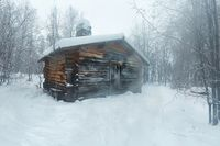 Winter Snowy Landscape with Log Cabin