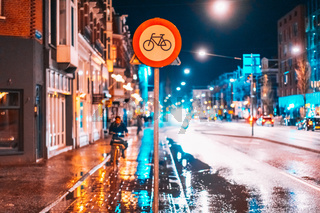 Bicycle lane sign on a night street