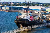 sea tug in modern seaport