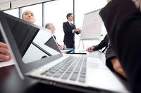Business presentation at flipchart