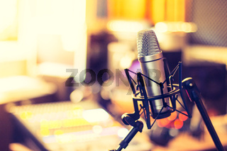 Professional studio microphone, recording studio, equipment in the blurry background