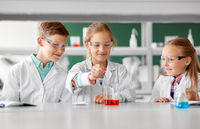 kids with test tube studying chemistry at school