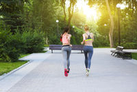 Runners training outdoors working out in the park
