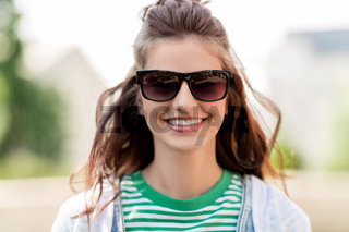 happy young woman in sunglasses outdoors