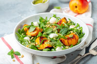 Salad with nectarines and peppermint pesto sauce.