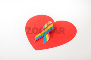 gay pride awareness ribbon on red heart