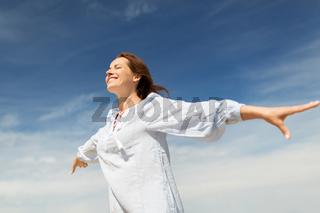 happy smiling woman enjoying summer