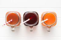 Glass of fruity juice.