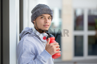 Sports training young latin man thinking emotion runner looking up copyspace copy space