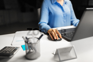 close up of businesswoman using computer mouse