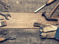 Old used tools on a workbench