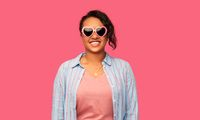 african american woman in heart-shaped sunglasses