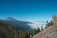 Tenerife mountain landscape with view on Pico del Teide summit above clouds