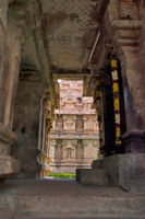 Part of the Brihadisvara Temple seen from the northern entrance to the mukhamandapa of Amman temple of goddess Brihannayaki, Gangaikondacholapuram, Tamil Nadu, India