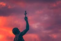 Catcher of a Cross statue
