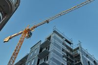 Urban Building Construction With Crane