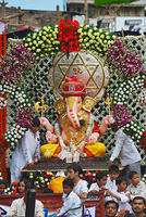 PUNE, INDIA, August 2011, People and devotee with Ganesh idol during Procession.