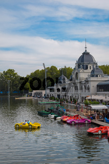 Budapest, Hungary, September , 13, 2019 - People using car shaped pedal boat in a lake in Varosliget park in a sunny day