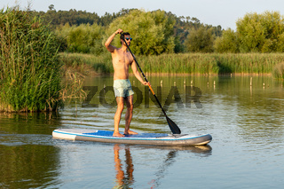 Man stand up paddleboarding