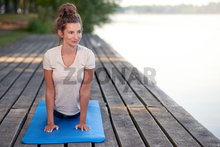 Attractive woman working out on a wooden deck