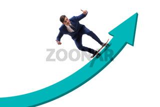 Businessman riding skateboard on financial graph