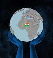 Niger on political globe in hands