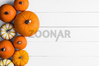 Pumpkins on wooden background