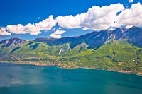 Lago di Garda and high mountain cliffs above Malcesine view