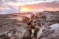 Waves splash up onto rocks on coast of Sydney