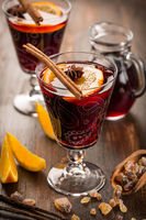 Hot cranberry mulled wine with oranges