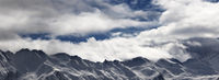 Ssnowy mountains and cloudy sky at evening