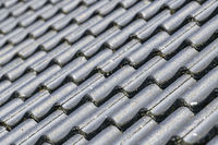 Black roof with concrete tiles