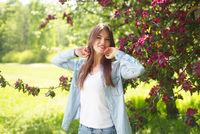 Woman near blooming tree