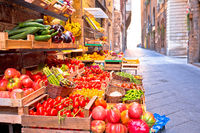 Fruit and vegetable market in narrow Florence street