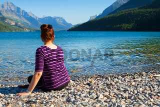 Girl Sitting At Lake In Waterton