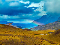 Magnificent rainbow crosses storm clouds