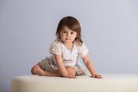 Pretty baby girl in white dress