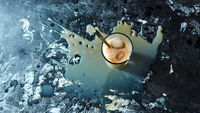 Cold coffee with milk with ice cubes with splashes on a black concrete background with space for text. Top view
