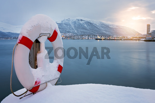 Lifebuoy covered in snow