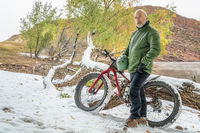 senior cyclist with a mountain fat bike