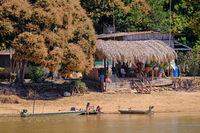 CORUMBA, MATO GROSSO, BRAZIL, JULY 23, 2018: Traditional indigenous girls along the Rio Paraguay river, Pantanal