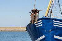 Bow with anchor shrimp fishing ship in Dutch harbor Lauwersoog